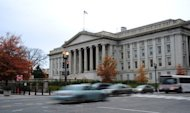 Vehicles drive by the US Treasury Building in Washington on November 15, 2011. With President Barack Obama heading back to Washington, Republicans heaped pressure on Democrats on Wednesday to lay out an 11th-hour deal preventing taxes from rising for all Americans.