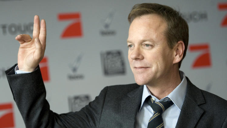 "Canadian actor Kiefer Sutherland poses during a photocall for the U.S. TV series ""Touch"" in Berlin Germany, March 9, 2012. The series will be broadcast on German TV starting on March 25. (AP Photo/dapd, Steffi Loos)"