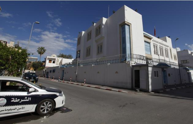 The car of a security company is seen parked in front of the Tunisian embassy in Tripoli
