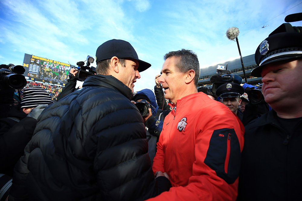 Jim Harbaugh's first meeting against Urban Meyer was an Ohio State rout last year. (Getty)