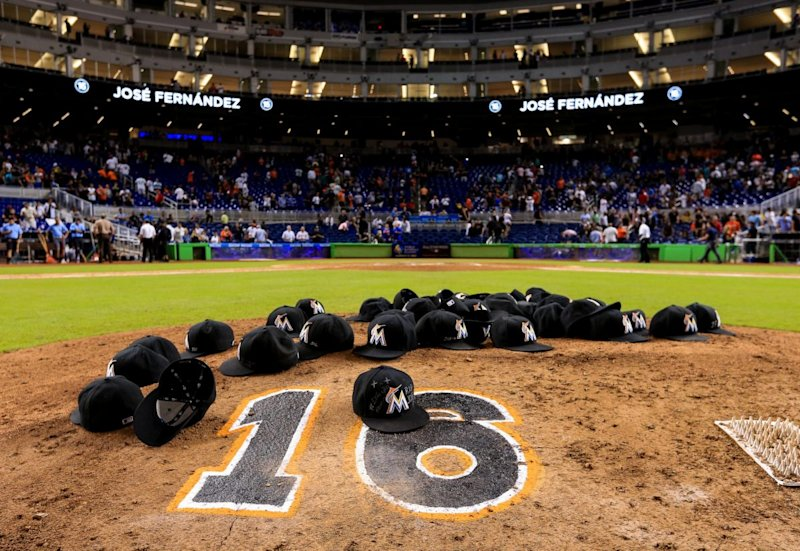 Jose Fernandez's Marlins teammates paid tribute by leaving their hats on the pitching mound after the game against the Mets at Marlins Park on Sept. 26. (Getty Images)