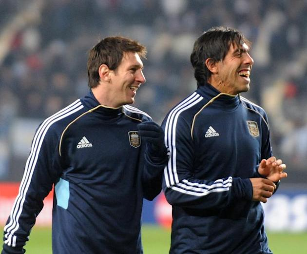 Argentine national footballers Lionel Messi (L) and Carlos Tevez laugh moments before the 2011 Copa America Group A first round football match against Bolivia, at the Ciudad de La Plata stadium in La