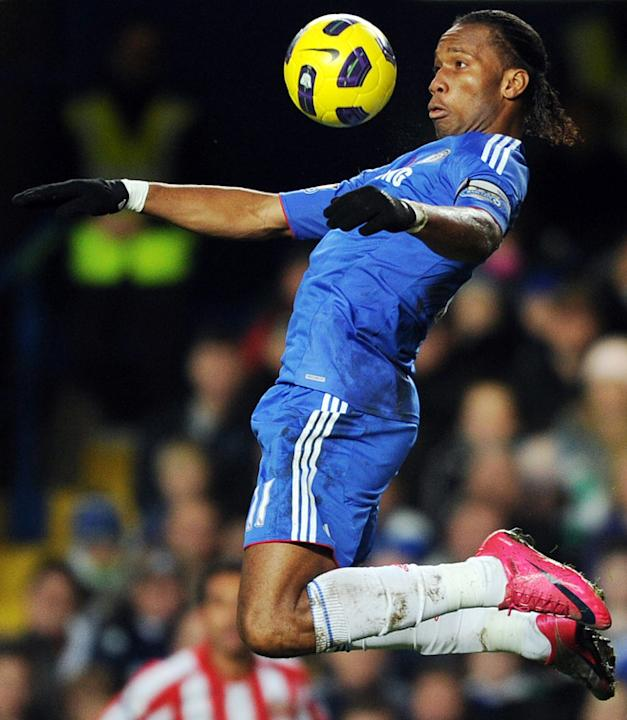 Chelsea's Ivorian Didier Drogba Jumps To Control The Ball Against Sunderland  AFP PHOTO / ADRIAN DENNIS ADRIAN DENNIS/ AFP/Getty Images