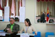 Mongolian voters fill in forms at a polling station in Ulan Bator, on June 26, 2013. Mongolians are voting in a presidential election pitting the front-running incumbent against a champion wrestler and a woman, amid calls for a fairer distribution of the former Soviet satellite's spectacular mining wealth