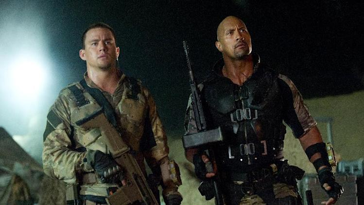 "This film image released by Paramount Pictures shows Channing Tatum, left, and Dwayne Johnson in a scene from ""G.I. Joe: Retaliation."" (AP Photo/Paramount Pictures, Jaimie Trueblood)"