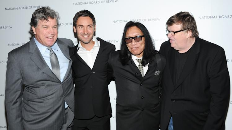 Sony Pictures Classics co-president Tom Bernard, left, director Malik Bendjelloul, musician Sixto Rodriguez and filmmaker Michael Moore, right, pose together at the National Board of Review Awards gala at Cipriani 42nd St. on Tuesday Jan. 8, 2013 in New York. (Photo by Evan Agostini/Invision/AP)