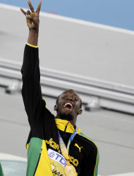 Jamaica's Usain Bolt celebrates with gold medal after winning the gold in the Men's 4x100m relay final at the World Athletics Championships in Daegu, South Korea, Sunday, Sept. 4, 2011. (AP Photo/Kevin Frayer)