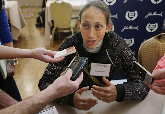 Boston Marathon runner Desiree Linden answers a reporter's question during a media availability of Boston Marathon elite runners at the Copley Plaza Hotel in Boston Friday April 18, 2014. The 118t