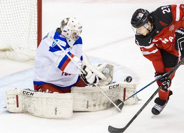 TORONTO, ON - JANUARY 05: Sam Reinhart #23 of Canada fires a shot against Igor Shestyorkin #30 of Russia during the Gold medal game of the 2015 IIHF World Junior Championship on January 05, 2015 at the Air Canada Centre in Toronto, Ontario, Canada. (Photo by Dennis Pajot/Getty Images)