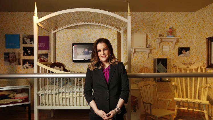 "The exhibit, ""Elvis Through His Daughter's Eyes,"" opens at Graceland in Memphis, Tenn., Wednesday, Feb. 1, 2012. Lisa Marie Presley was born on Feb. 1, 1968. (AP Photo/Lance Murphey)"
