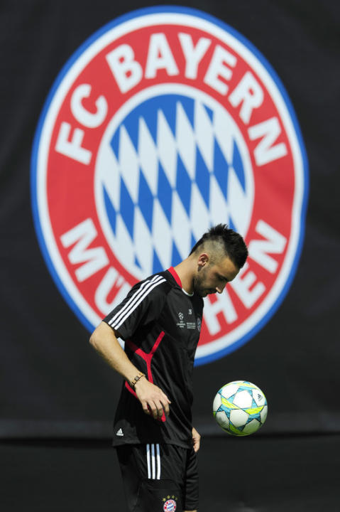 Bayern Munich's Defender Diego Contento Controling The Ball In Front Of A Logo Of German Soccer Club FC Bayern Munich AFP/Getty Images