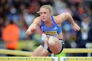 Australia's Sally Pearson clears a hurdle in her women's 100m hurdles semi-final at the 2012 Diamond League athletics meet at Crystal Palace in London. Olympic favourite Pearson, the 2011 world championship gold medallist, was beaten in the 100m hurdles for only the second time in 34 races as American Kellie Wells stormed home in 12.57secs