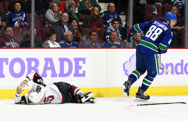 VANCOUVER, BC - NOVEMBER 17: Nikita Tryamkin #88 of the Vancouver Canucks skates away after colliding with Brad Richardson #15 of the Arizona Coyotes during their NHL game at Rogers Arena November 17, 2016 in Vancouver, British Columbia, Canada. (Photo by Jeff Vinnick/NHLI via Getty Images)