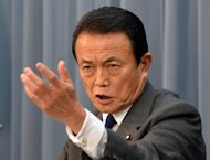 Japanese Finance Minister Taro Aso speaks at a press conference in Tokyo, on Janaury 15, 2013. Japan logged a $7.2 billion trade deficit in December, bringing the total trade gap to a record $78 billion for 2012, official data showed on Thursday