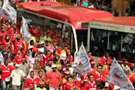 Workers march and chant slogans during a May Day rally in Kuala Lumpur. Several dozen workers and activists gathered in Kuala Lumpur as Malaysian Prime Minister Najib Razak announced the country's first ever minimum wage for private sector employees