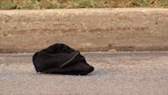 Clothing lies on the road at 82 Street and 141 Avenue where an 18-year-old woman was killed in a hit-and-run Sunday morning.