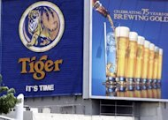 A huge billboard advertising Tiger Beer -- brewed by Asia Pacific Breweries (APB) -- in Singapore. The Asia-Pacific region accounts for more than a third of global beer consumption and industry analysts expect demand to grow further as sales taper off in mature markets like North America and Europe