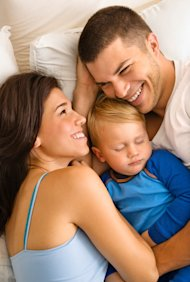 112310_parents_sharing_bed_iStock_000004516775Small