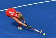 Britain's Crista Cullen shoots a goal during their women's field hockey bronze medal match against New Zealand at The Riverbank Arena in London. Britain won 3-1