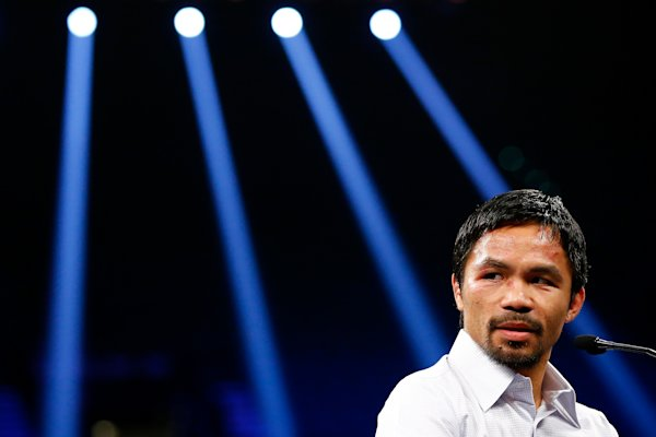 LAS VEGAS, NV - MAY 02: Manny Pacquiao answers questions during the post-fight news conference after losing to Floyd Mayweather Jr. in their welterweight unification championship bout on May 2, 2015 at MGM Grand Garden Arena in Las Vegas, Nevada. Al Bello/Getty Images/AFP (AFP Photo/AL BELLO)