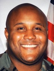 Fired Los Angeles Police Department (LAPD) officer Christopher Dorner seen in an undated photo wearing a military uniform. More than 100 officers have been searching in the mountains since Thursday for Dorner, 33.