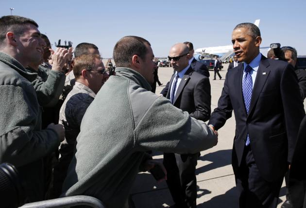 U.S. President Barack Obama shakes hands with supporters after arriving in Pittsburgh aboard Air Force One