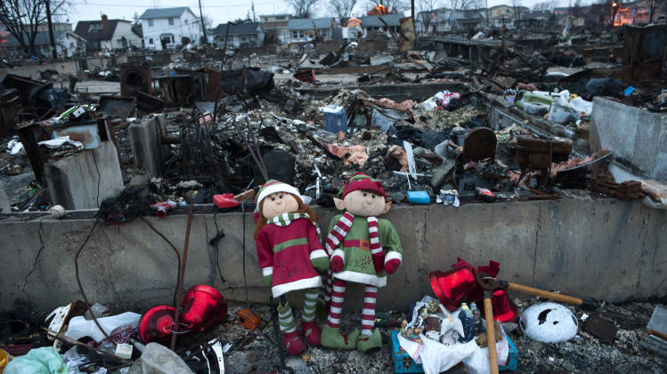 Christmas ornaments amongst the remains of homes destroyed by fire during Hurricane Sandy in the Breezy Point area of New York's borough of Queens