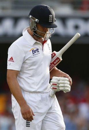 England's Jonathan Trott walks off the field after his dismissal by Australia's Mitchell Johnson during the third day's play of the first Ashes cricket test match in Brisbane