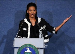 Michelle Obama in a Chanel inspired coat from White House, Black Market