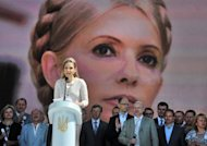 The daughter of Ukraine's jailed former Prime Minister Yulia Tymoshenko, Eugenia, speaks before a screen displaying her mother's image in Kiev on May 12. Ukraine's general prosecutor said Wednesday Yulia Tymoshenko was cited as a witness in the murder of a deputy, putting fresh pressure on President Viktor Yanukovych's arch-enemy