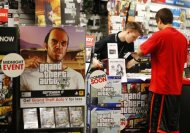 "Game enthusiasts purchase the latest release of ""Grand Theft Auto Five"" after the game went on sale at the Game Stop store in Encinitas, California September 17, 2013. REUTERS/Mike Blake"
