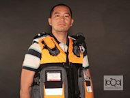 "Entrepreneur Danvic Briones wears the Rescue 72 Vest Bag, a ""grab-and-go"" kit he says can store three days worth of basic supplies one needs in time of disaster."