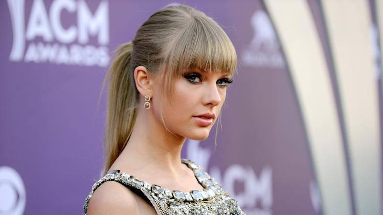 Singer Taylor Swift arrives at the 48th Annual Academy of Country Music Awards at the MGM Grand Garden Arena in Las Vegas on Sunday, April 7, 2013. (Photo by Al Powers/Invision/AP)