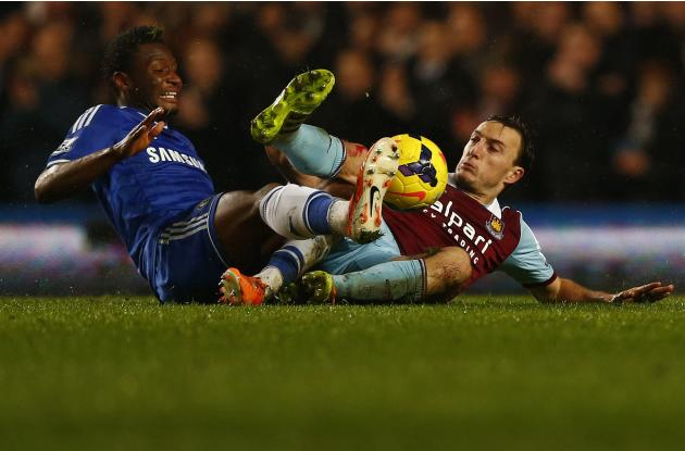 Chelsea's Obi Mikel challenges West Ham United's Noble during their English Premier League soccer match at Stamford Bridge in London