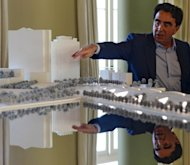 "Internationally-renowned architect Santiago Calatrava shows the model of the ""Museum of Tomorow"" project in Rio de Janeiro. The ""sustainably-focused"" museum is part of a massive urban revitalization project launched by the city in preparation for the 2016 Olympic Games"