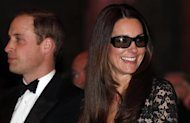 "Catherine, the Duchess of Cambridge, wears 3D glasses before a screening of ""David Attenborough's Natural History Museum Alive 3D"" with her husband Britain's Prince William at the Natural History Museum in London December 11, 2013. REUTERS/Suzanne Plunkett"