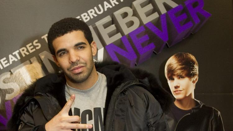 "FILE - In a Feb. 1, 2011 file photo Rapper Drake arrives at the screening of the film ""Justin Bieber: Never Say Never"" in Toronto. Drake received five nominations for the MTV Video Music Awards in 2012. (AP Photo/The Canadian Press, Darren Calabrese, file)"