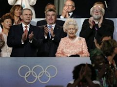 Britain's Queen Elizabeth II, center, the President of the International Olympic Committee Jacques Rogge, left, and Britain's Archbishop of Canterbury