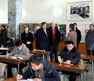 This photo, taken by North Korea's official Korean Central News Agency on January 9, 2013, shows former New Mexico Governor Bill Richardson (centre, L) and Google executive chairman Eric Schmidt (centre, R) visiting the Grand People's Study House in Pyongyang. Richardson and Schmidt were in North Korea for a 'private trip.'