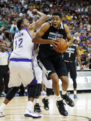Karl Anthony Towns' first shot as a pro was just a bit short. (AP Photo/John Locher)