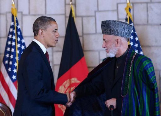Afghan President Hamid Karzai (R) shakes hands with US President Barack Obama after signing a strategic partnership agreement on May 1 at the Presidential Palace in Kabul. Iran's foreign ministry on Sunday denounced a new strategic pact signed between Afghanistan and the United States, saying it would give rise to instability in the neighbouring country