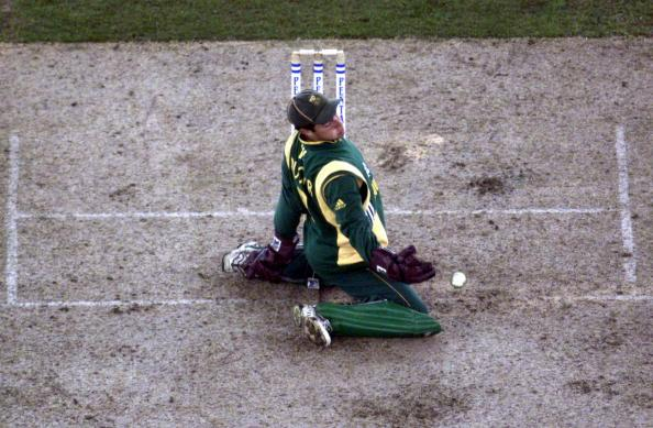 16 Aug 2000:   Mark Boucher of South Africa slides as he takes the return, in the match between Australia and South Africa, in game one of the Super Challenge 2000, played at Colonial Stadium in Melbo