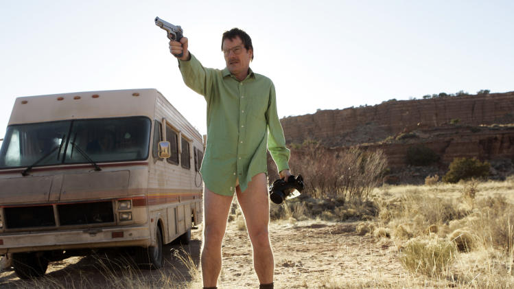 "This image released by AMC shows Walter White, played by Bryan Cranston, next to the Winnebago he uses as a mobile meth lab in the pilot episode of ""Breaking Bad."" The series finale of the popular drama series aired on Sunday, Sept. 29. (AP Photo/AMC, Doug Hyun)"