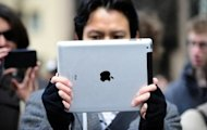 Apple products like the iPad2 have become a symbol of wealth for many young Chinese. (AFP)