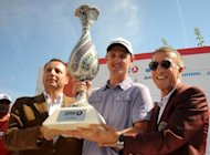 Justin Rose (centre) poses with the trophy after winning the Turkish Airlines World Golf Final final Day in Antalya on Friday. Rose drew on memories of last month's Ryder Cup singles defeat of Phil Mickelson to also defeat fellow England golfer Lee Westwood by a stroke and capture the World Golf Final title