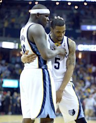MEMPHIS, TN - APRIL 24: Zach Randolph #50 and Courtney Lee #5 of the Memphis Grizzlies hug after the 98-95 OT win over the Oklahoma City Thunder in Game 3 of the Western Conference Quarterfinals during the 2014 NBA Playoffs at FedExForum on April 24, 2014 in Memphis, Tennessee. NOTE TO USER: User expressly acknowledges and agrees that, by downloading and or using this photograph, User is consenting to the terms and conditions of the Getty Images License Agreement. (Photo by Andy Lyons/Getty Images)