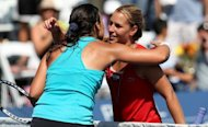 "Slovakia's Dominika Cibulkova (R) hugs France's Marion Bartoli after their Mercury Insurance Open final match on July 22. ""I lost, but Dominika played a great match,"" said Bartoli"