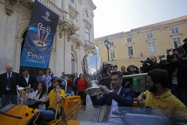 Former Portuguese soccer player Baia and Jorge, former coach of the Portuguese women's national team, sit with the Champions League and the women's Champions League trophies respectively in Li