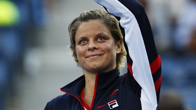 Kim Clijsters of Belgium waves to the gallery after her loss to Laura Robson of Britain in their women's singles match at the US Open (Reuters)