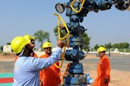 Engineers inspect a newly-officiated Oil & Natural Gas Corporation (ONGC) oil well near Kalol, 2009. India's state-run oil firm ONGC plans to press ahead with long-term partner Vietnam in exploring the disputed South China Sea for oil, shrugging off complaints by China